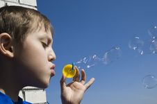 Free Boy Blowing Soap Bubbles Royalty Free Stock Photos - 7929918