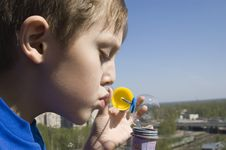 Free Boy Blowing Soap Bubbles Royalty Free Stock Photography - 7929927