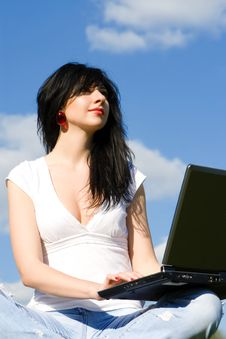 Free Woman With Laptop On Sky Background Royalty Free Stock Photo - 7930225