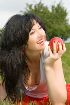 Free Woman Eating Red Apple On The Summer Glade Royalty Free Stock Photography - 7930247