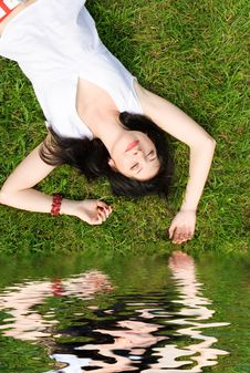 Woman Rest On The Grass Stock Images