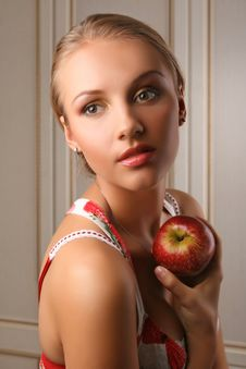 Attractive Young Woman Holding Red Apple Stock Image