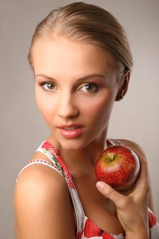 Attractive Young Woman Holding Red Apple Stock Photography