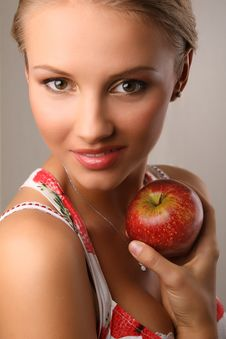 Free Attractive Young Woman Holding Red Apple Stock Photos - 7931803