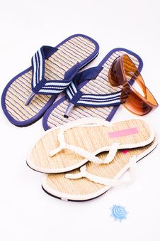 Free His And Hers Flip Flops And Sunglasses Stock Photos - 7932413