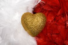 Heart Over White And Red Feathers Background Stock Image