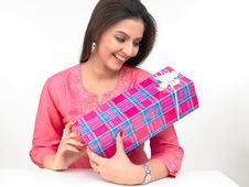 Free Young Woman With A Gift Box Stock Photos - 7934163