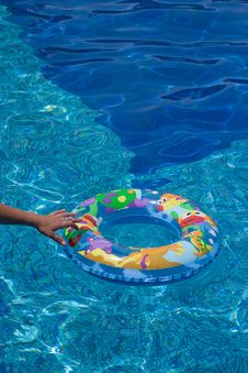 Free Hand Reaching For The Rubber Swimming Ring Stock Image - 7935861