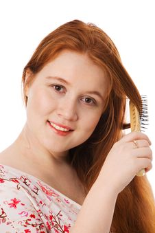 The Young Beautiful Woman Combs Long Red Hair Royalty Free Stock Photos