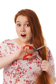 Free The Young Woman Cuts Red Hair, Is Afraid Royalty Free Stock Photography - 7937297