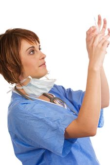 Free Female Doctor Tapping Filled Syringe Royalty Free Stock Photos - 7937618