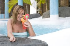 Beautiful Woman With Cocktail In A Swimming Pool Royalty Free Stock Photos