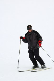 Man Skiing Fast Stock Images