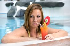 Beautiful Woman With Cocktail In A Swimming Pool Royalty Free Stock Images