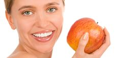 Free Happy Woman With A Red Apple Stock Photos - 7941313