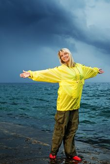 Free Woman In Yellow Raincoat Royalty Free Stock Image - 7942046