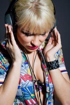 Fashion Woman Listening Music In Headphones Stock Photo
