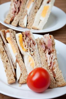 Bacon, Egg And Sausage Sandwiches Royalty Free Stock Photo