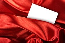 Free Blank White Card On Red Colored Satin Cloth Stock Photos - 7943653