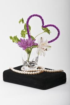 Free Flowers In A Glass With Pearls On A Jewelry Box Stock Photos - 7943963