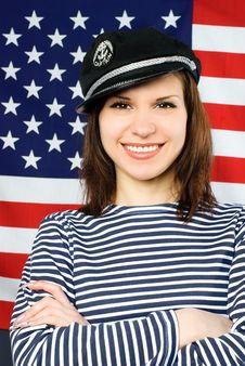 Free Beautiful Sailor Standing Near The American Flag Stock Photos - 7944053
