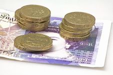 Pound Coins And Twenty Quid Royalty Free Stock Image