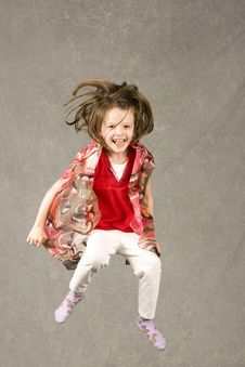 Free Little Girl Leaping Into Air Stock Images - 7945464
