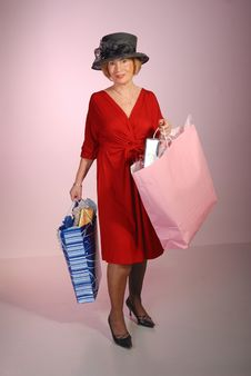 Free Attractive Older Lady Holding Shopping Bags Royalty Free Stock Photos - 7947368