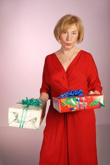 Free Attractive Older Woman Holding Gifts Royalty Free Stock Image - 7947396