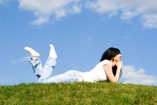 Woman Rest On The Green Grass Stock Photo
