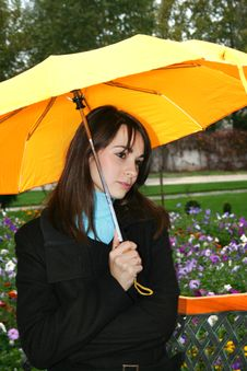 Free Woman Holding A Umbrella Royalty Free Stock Image - 7951296