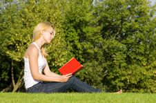 Free Blonde Reads Book In The Park Stock Photo - 7951710