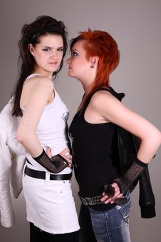Two Models In Colorful Setting In The Studio Stock Photos