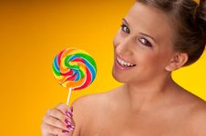 Free Smiling Brunette Woman With Big Lollipop Stock Image - 7952971