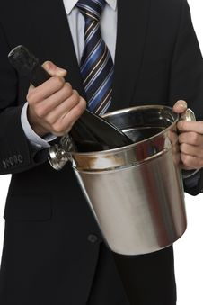 Man With Suit Champagne Bottle In Ice-pail Royalty Free Stock Photography
