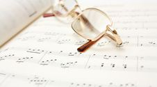 Free Glasses On Book Of Notes Royalty Free Stock Images - 7957019
