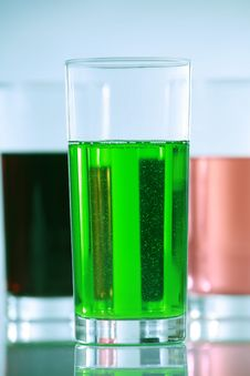 Three Glasses With Colorful Drinks Stock Images