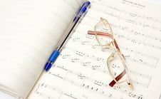 Glasses And Pencil On Book Stock Photography