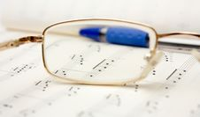 Glasses And Pencil On Book Royalty Free Stock Images