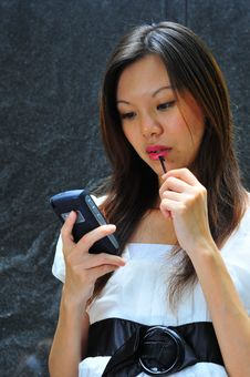Free Asian Modern Woman Unsure Of Her Message Stock Photo - 7960620