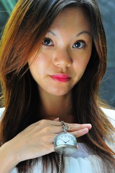 Free Modern Chinese Woman Showing A Watch Telling Time Stock Photography - 7962832