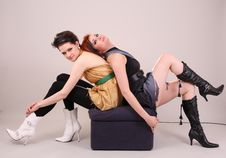 Two Models In Colorful Setting In The Studio Royalty Free Stock Image