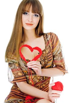 Young Blond With A Red Knit Heart Stock Photo