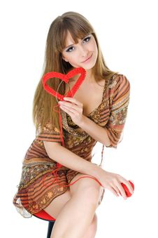 Young Blond With A Red Knit Heart Royalty Free Stock Image