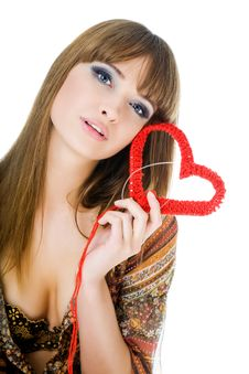 Young Blond With A Red Knit Heart Stock Images