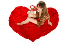 Free Young Blond With A Red Knit Heart Stock Images - 7965824