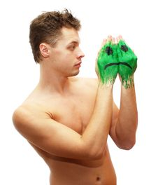 Free Sad Young Man Looking At Sad Smile Mask Painted On Stock Photos - 7969063