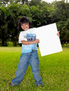 Free Girl With A Blank Placard In The Garden Stock Images - 7973914
