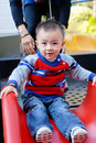 Free The Asian Boy Playing The Sliding Board Stock Image - 7978091