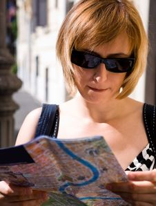Free Lovely Woman With Map Of City Stock Image - 7971161